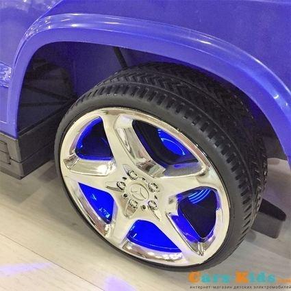 Толокар Mercedes-Benz GL63 A888AA-H с ручкой и качалкой красный (музыка, свет фар и колес, колеса резина, сиденье кожа)